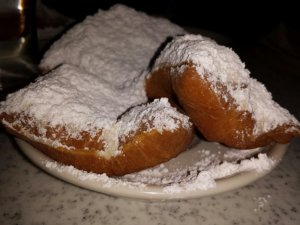 Icing sugar coated beniets